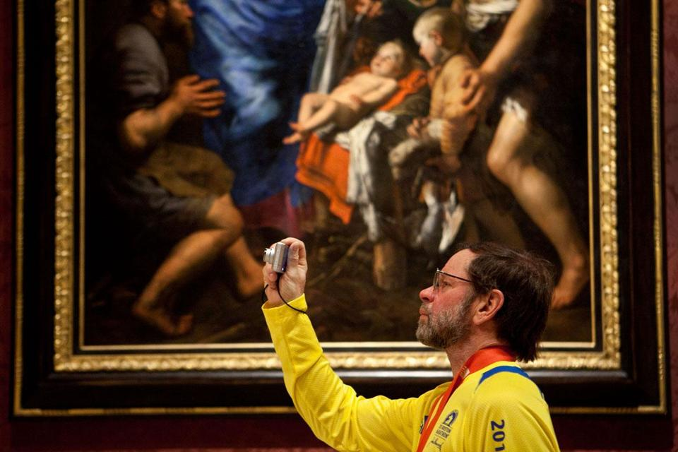 Bruce Lindell of Plymouth, Minn, who came to Boston to run the Marathon, photographed artwork at the Museum of Fine Art Tuesday.
