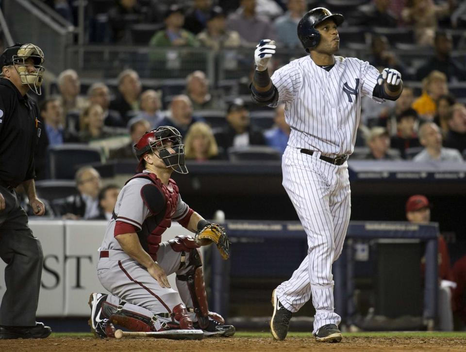 Yankees second baseman Robinson Cano admires his three-run blast in the fourth inning against Arizona.