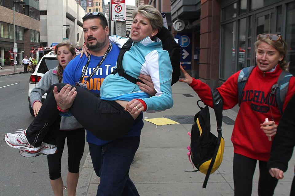 "Ex-Patriot Joe Andruzzi carried an injured woman to safety Monday. ""There was just chaos, like a battle scene,'' he said."
