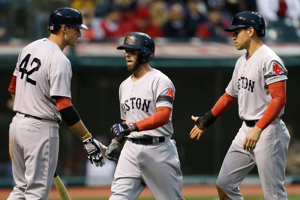Will Middlebrooks, left, congratulated Dustin Pedroia and Jacoby Ellsbury after they scored on a bases-loaded double by Mike Napoli in the second inning.