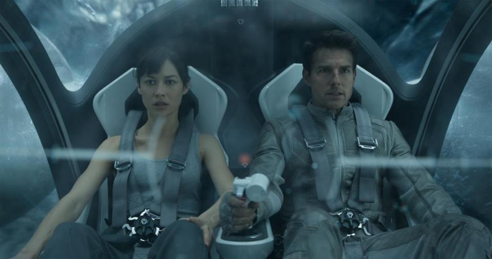 "Olga Kurylenko and Tom Cruise in a scene from ""Oblivion."""