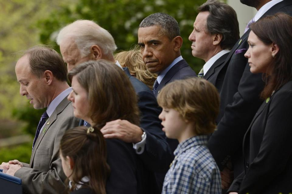 President Obama and Vice President Joe Biden listened to remarks from Mark Barden, whose child was murdered at Sandy Hook Elementary School, alongside other victims of gun violence who were at the White House April 17.