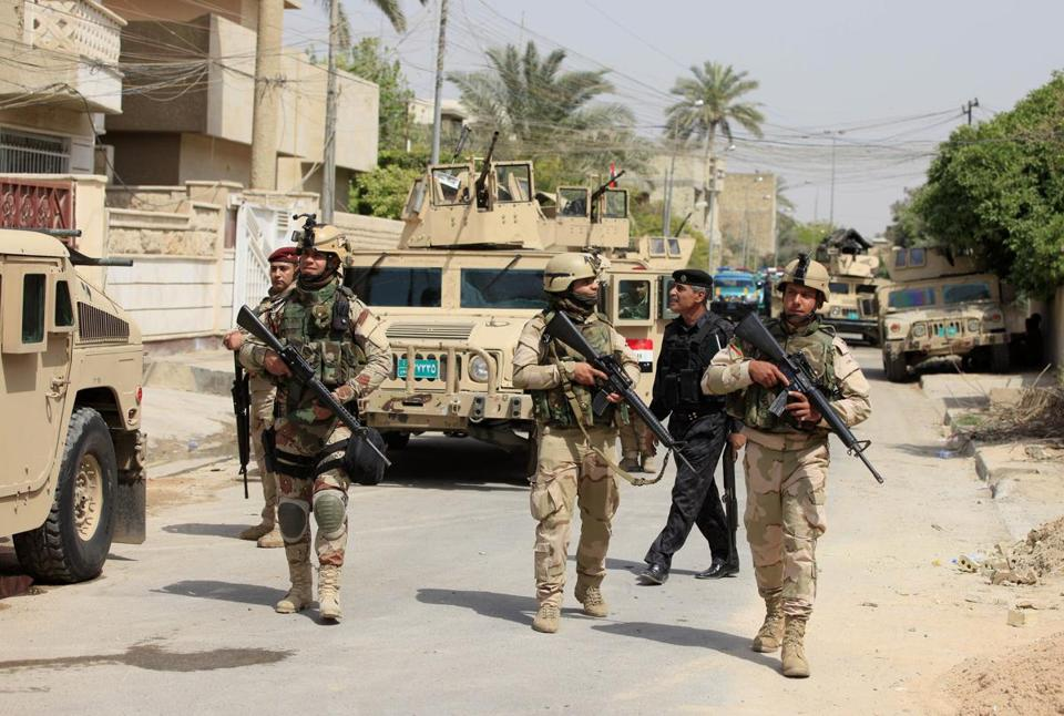 Iraqi Army soldiers patrolled in Baghdad's Adhamiya district Thursday. Violence has been on the rise ahead of provincial elections to be held on Saturday.