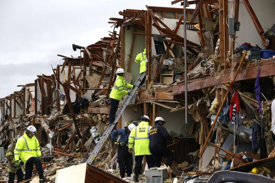 Firefighters carefully searched Thursday for survivors in an apartment building destroyed by a fertilizer plant explosion.