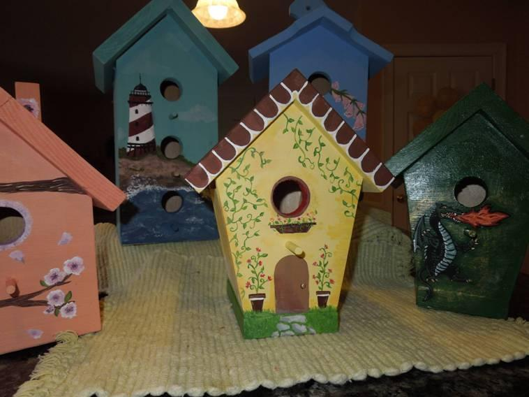Painted birdhouses by Emily Whynott, 14, of Plymouth