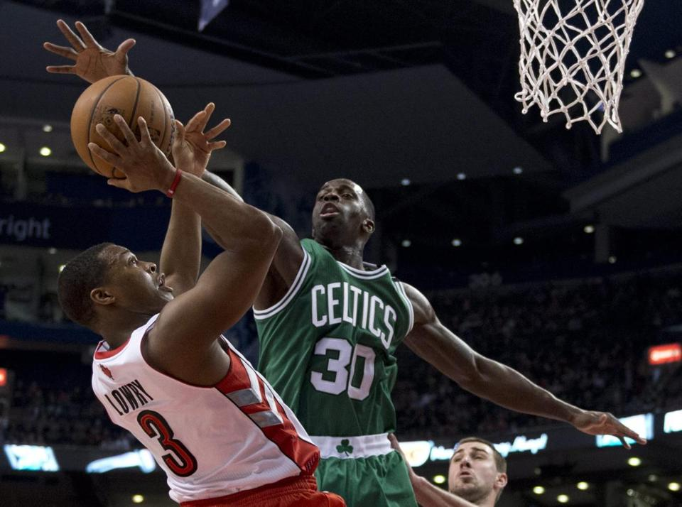 Celtics forward Brandon Bass tries to block a shot from Kyle Lowry during first-half Wednesday night.