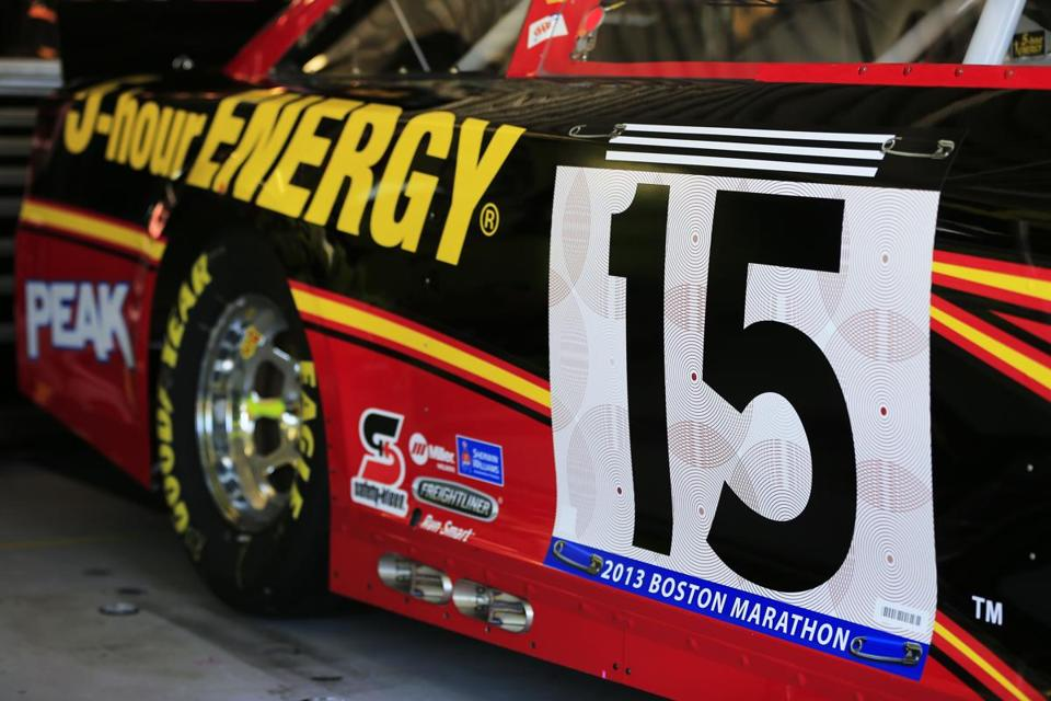 "Driver Clint Bowyer's car has a paint scheme that looks like a runner's bib with the words ""2013 Boston Marathon"" at the Kansas Speedway Friday."