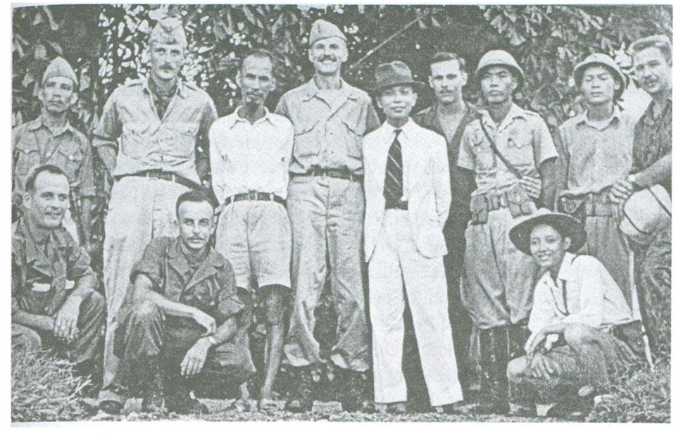 Henry A. Prunier (center) parachuted into Indochina during World War II to train insurgents.
