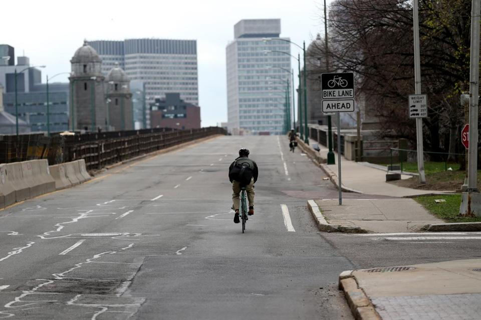 Amid the lock-down that paralyzed the area, a lone bicycle rider headed across the Longfellow Bridge.