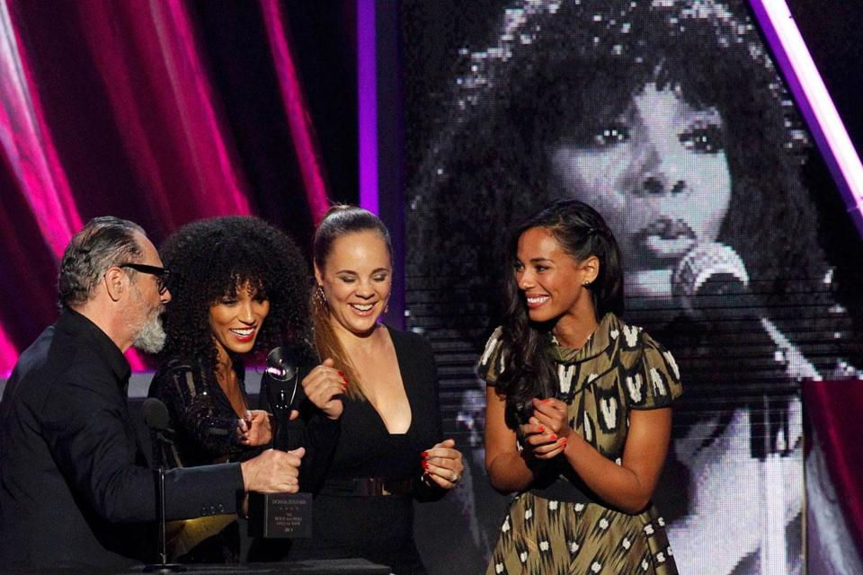From left: the late Donna Summer's husband, Bruce Sudano, and daughters Brooklyn Sudano, Mimi Dohler, and Amanda Sudano Ramirez at Summer's Rock and Roll Hall of Fame induction ceremony.