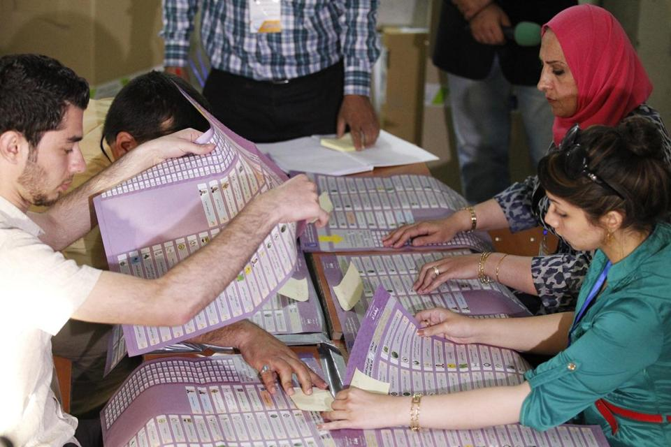 Election workers counted ballots at a polling station in Baghdad on Saturday. In some places, Iraqis could not cast ballots because their names did not show up on voter rolls.