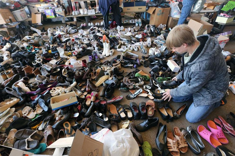 A volunteer sorted donated shoes for residents who were affected by the massive fertilizer plant explosion that demolished part of the town of West, Texas.