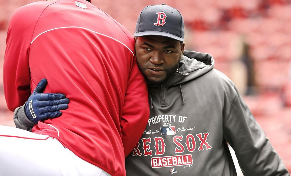 David Ortiz hugs a teammate during batting practice before the Red Sox game against the Royals.