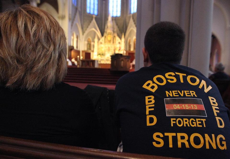 A T-shirt designed by a Boston firefighter was seen at Sunday's service at the Cathedral of the Holy Cross.