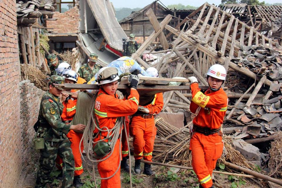 An injured man was carried from his home after an earthquake struck Sichuan Province.