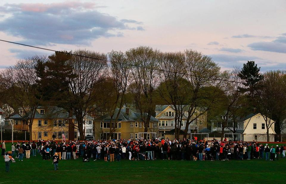 Watertown residents gathered to attend a candlelight vigil at Victory Park on April 20.
