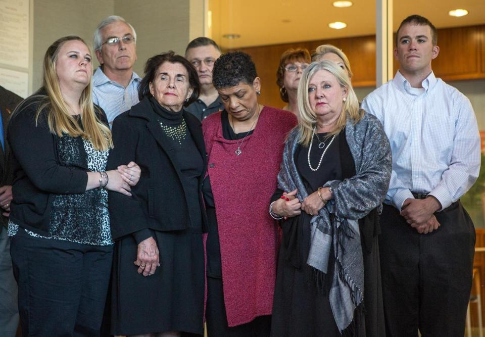 From left, MBTA police officer Richard Donohue Jr.'s sister, Consuelo Donohue-Anderson; father, Richard; grandmother Barbara O'Connell; Beverly Scott, MBTA general manager; Donohue's mother, Consuelo; and his brother Edward at Sunday's press conference.