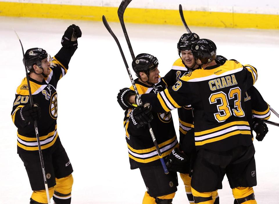Bruins defenseman Zdeno Chara celebrated with the team after beating the Panthers, 3-0.