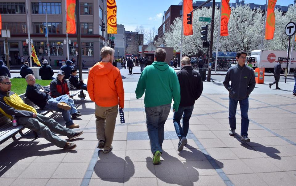 Pedestrians enjoyed the sunshine in Kendall Square on Monday.