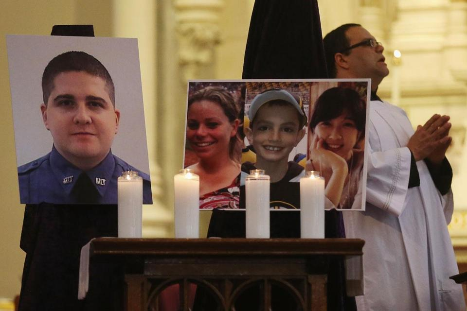 Photos of violence victims Sean Collier, Krystle Campbell, Martin Richard, and Lingzi Lu were on view at the Cathedral of the Holy Cross Sunday.