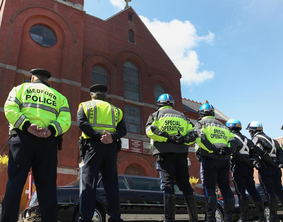 Police officers formed a line outside St. Joseph Parish in Medford for Krystle Campbell's funeral on Monday.