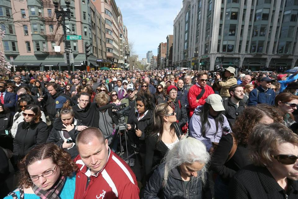 A moment of silence was held Monday on  Boylston Street, one week after the bombings at the Boston Marathon.  David L. Ryan Photo/Globe Staff.