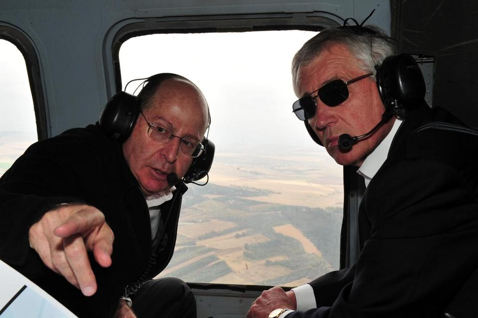 Defense Secretary Chuck Hagel (right) and his counterpart Moshe Yaalon, Israel's minister of defense, spoke during a helicopter tour of the Golan Heights Monday.