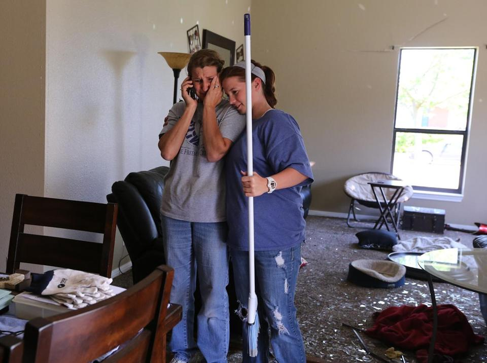 Trish Webre (left) was comforted by her niece Caitlin Poteet after returning to her home in West, Texas, on Monday, five days after a massive blast at a local fertilizer plant killed 14.