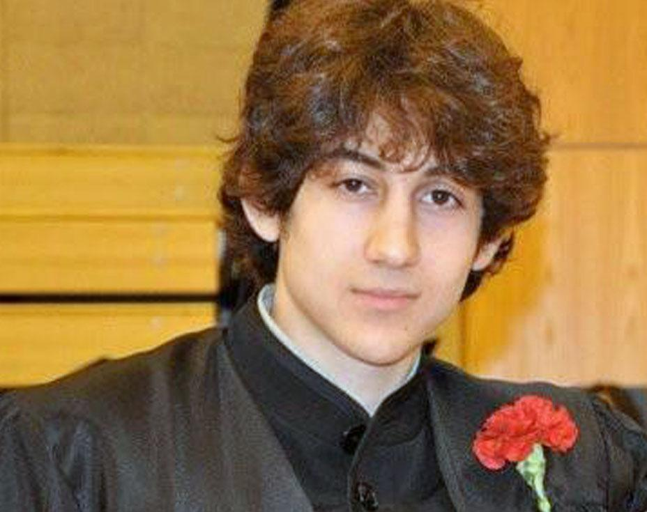 Boston Marathon bombing suspect Dzokhar A. Tsarnaev, shown in a high school graduation photo, was allegedly seen on video dropping a bomb before it went off.