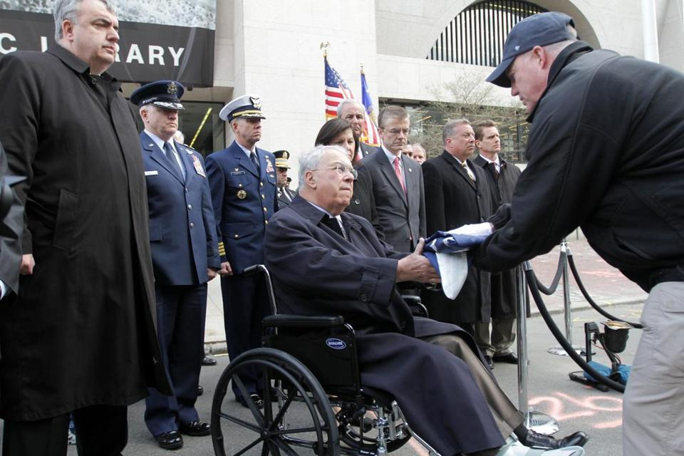 Mayor Thomas Menino of Boston received the US flag that was flown over the finish line at the Boston Marathon from an FBI official, who symbolically turned jurisdiction of the bombing site over to the city Monday.