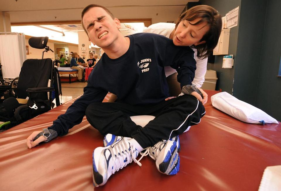 Jared Coppola of North Reading undergoes phsical therapy with Corrie Abegglen at Atlanta's Shepherd Center.