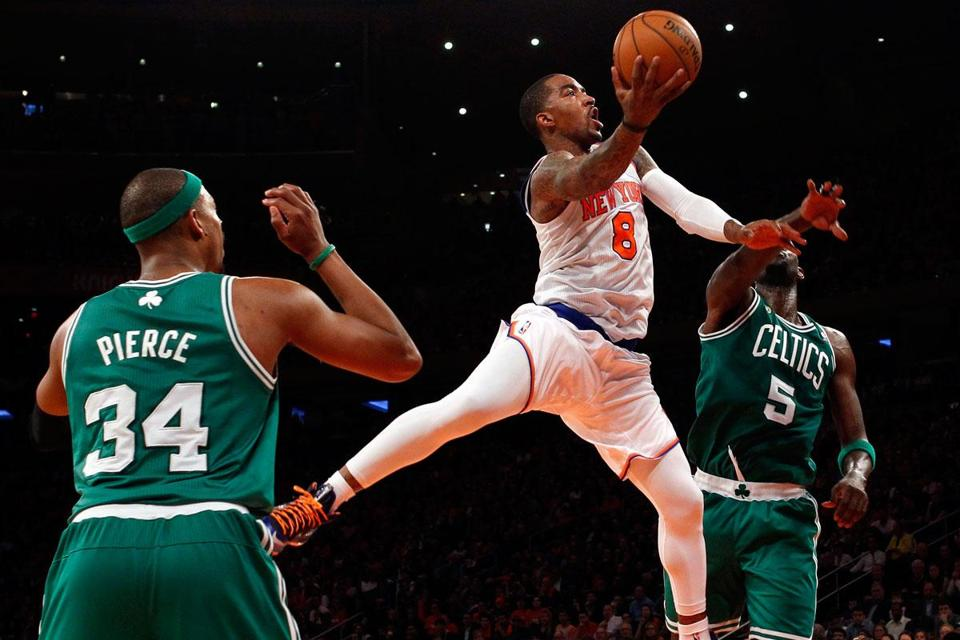 Knicks guard J.R. Smith split the defense of Paul Pierce and Kevin Garnett in the second half of Game 1.
