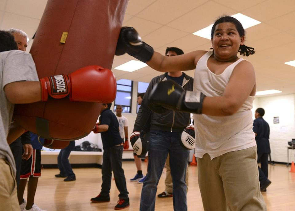 Christian Kavanaugh, 12, takes his turn at the heavy bag  for a punching drill at the Teen Center.