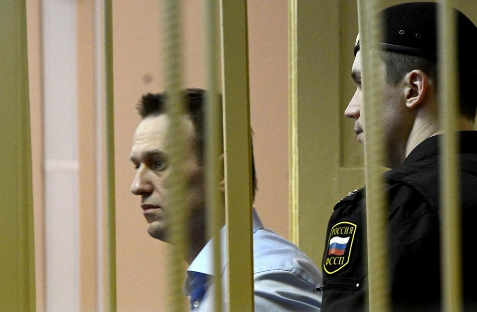 Russian protest leader Alexei Navalny walked past a guard as he attended a hearing the northern city of Kirov.