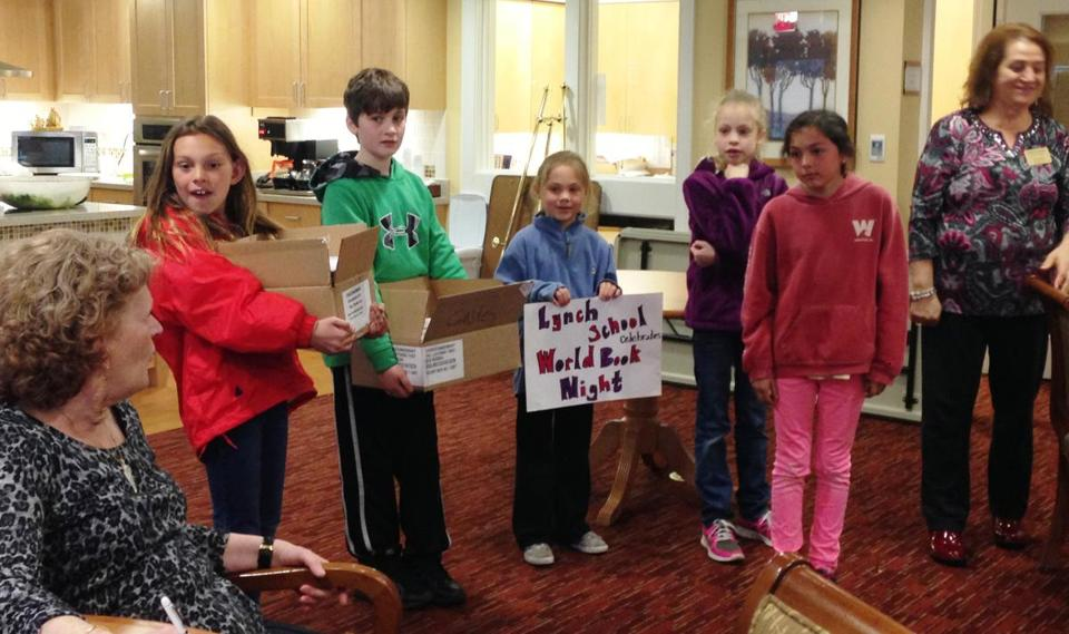 Students from Winchester's Lynch Elementary School deliver books to The Gables at Winchester retirement community last week. From left: Lilly Stone, Johnny Yanucci, Sadie Stone, Grace Yanucci, and Ella Stone.