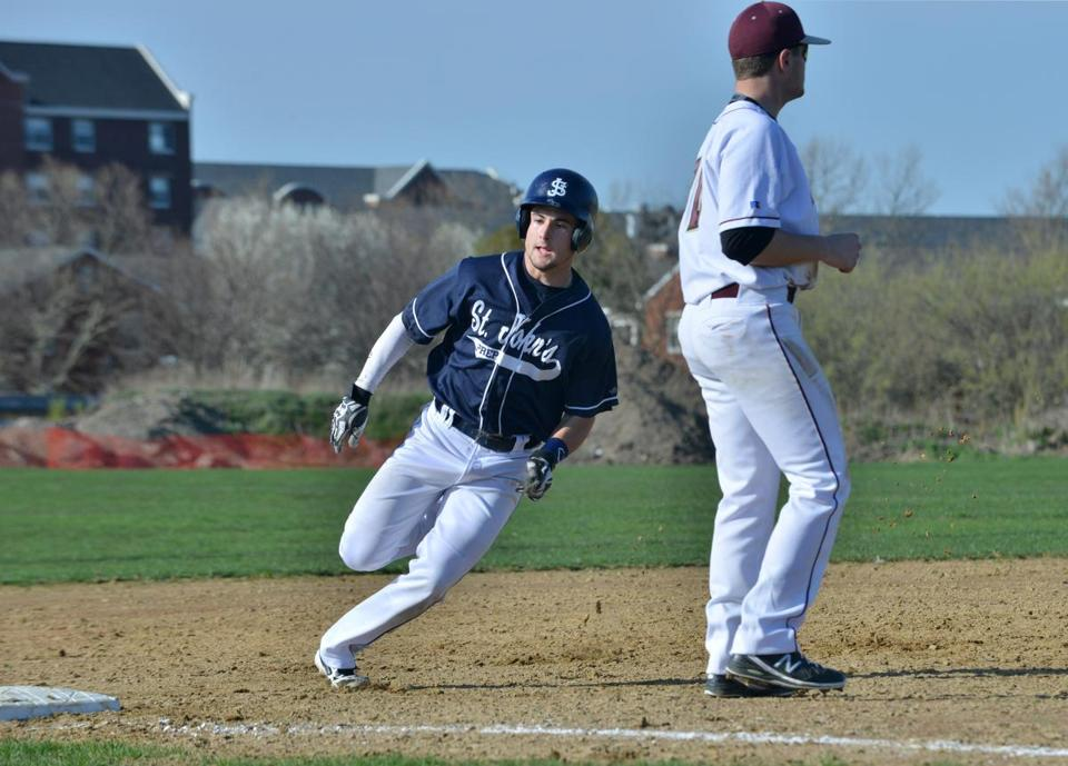 St. John's Prep's Tommy Buonopane rounds third behind BC High's Tom Russo. The hosts lost the battle of Eagles.