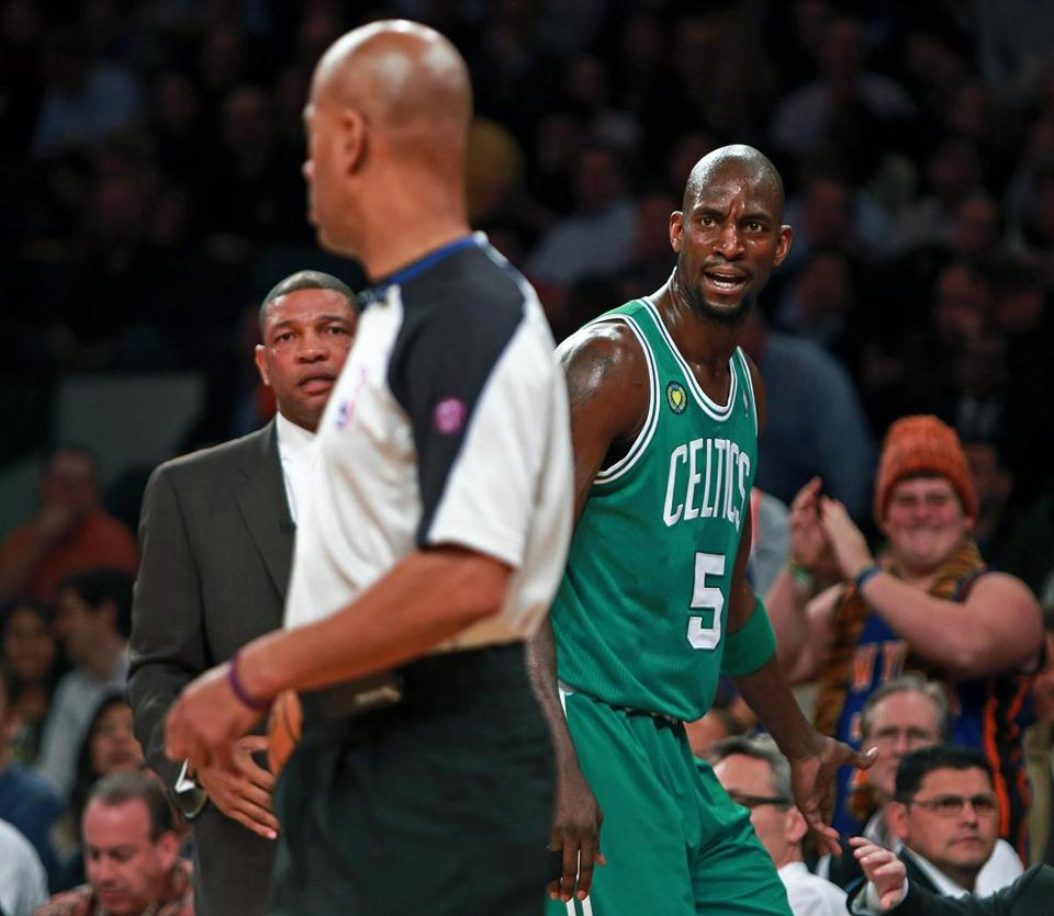 Kevin Garnett scowls at an official after being called for his second foul.