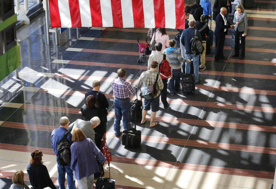 A long line of passengers waited to go through a security checkpoint at Reagan National Airport in Washington on Thursday.