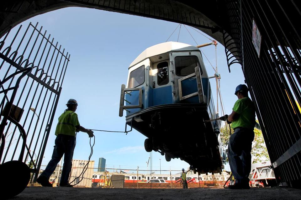 MBTA workers move a retired Blue Line subway car in 2012.