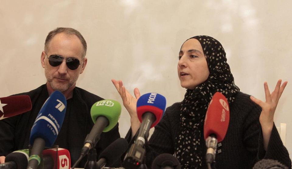 The mother of the two Boston bombing suspects, Zubeidat Tsarnaeva, with the suspects' father Anzor Tsarnaev, left, spoke at a news conference in Makhachkala, Russia.