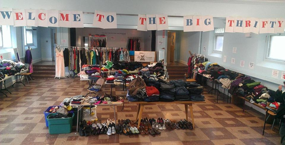 Goods are laid out at the 2012 Big Thrifty used clothing sale in Somerville for plus-size shoppers of all genders, sizes XL and up.