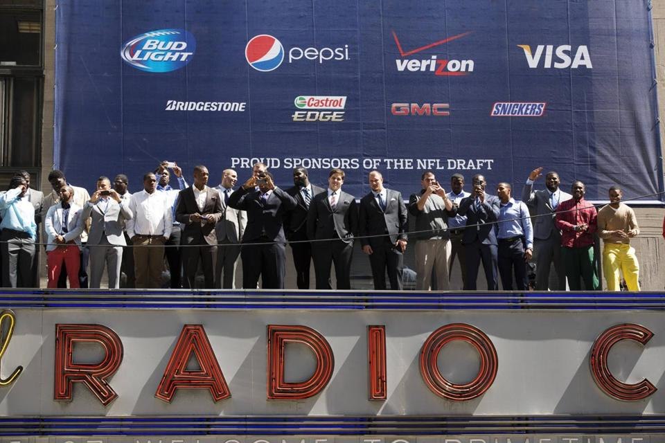 The NFL showed off some of the draft's top prospects atop the marquee at Radio City Music Hall, site of the draft.