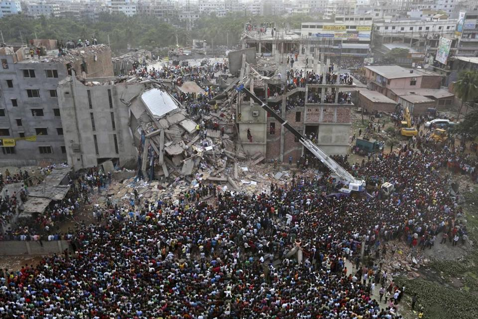 People gathered in Savar, Bangladesh, on Thursday as rescuers looked for survivors and bodies at the site of a building that collapsed Wednesday.
