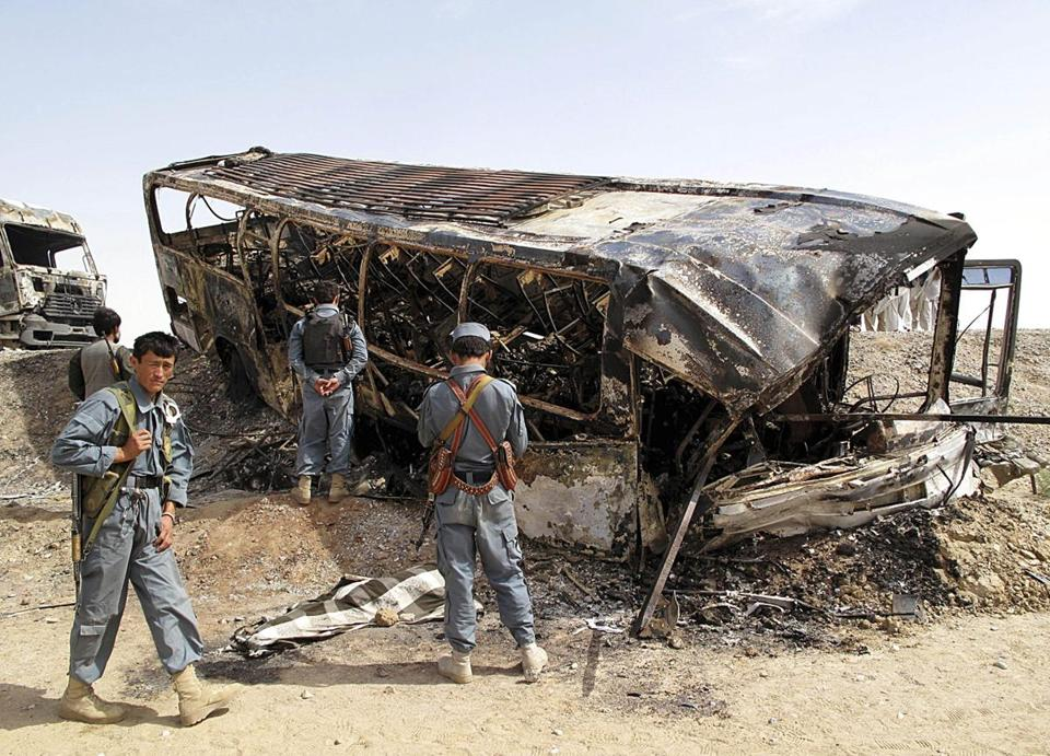 Police inspected a bus that collided with the wreckage of a tanker that had been attacked by the Taliban days earlier.