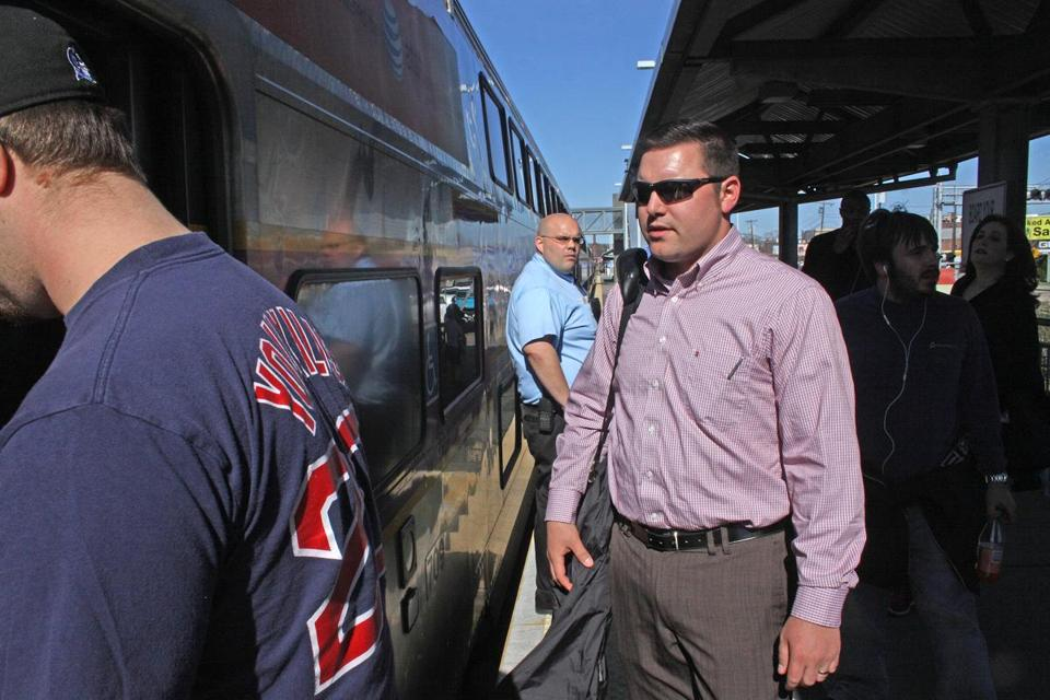 Douglas Tetrault of Boston boards a commuter train bound for Boston at Framingham's MBTA stop Wednesday afternoon.