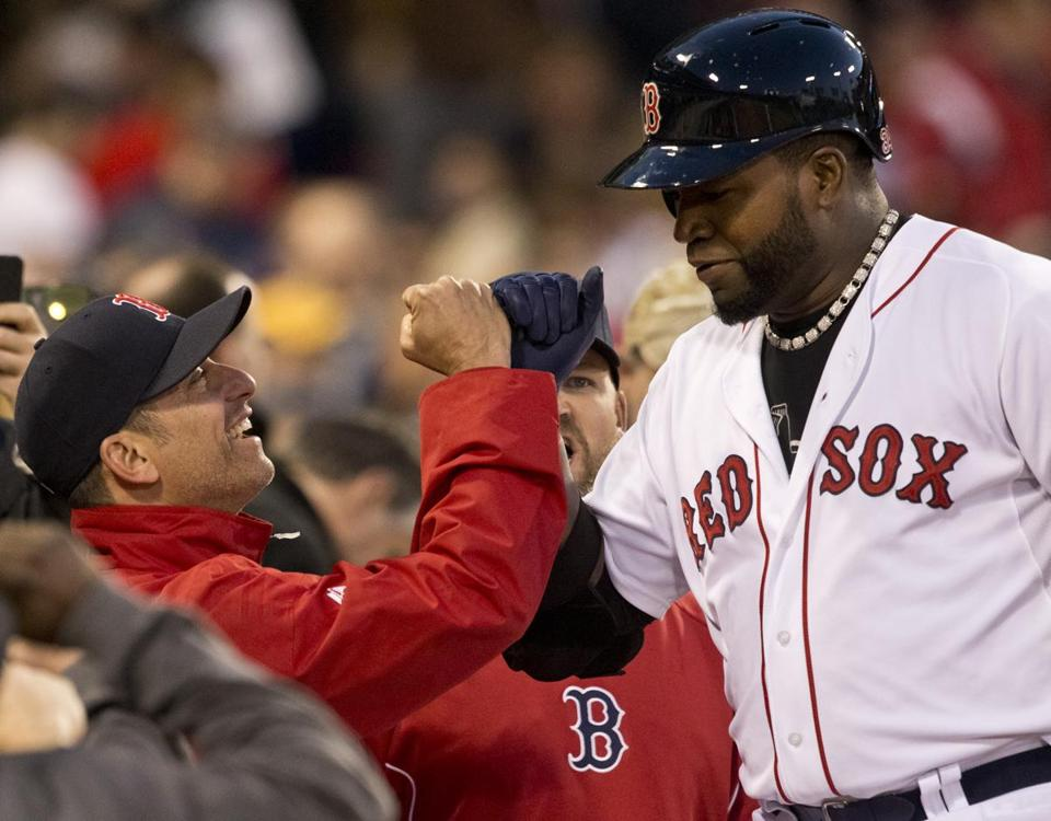 David Ortiz fist bumps bench coach Terry Lovullo after hitting a solo home run against the Astros in the third inning.