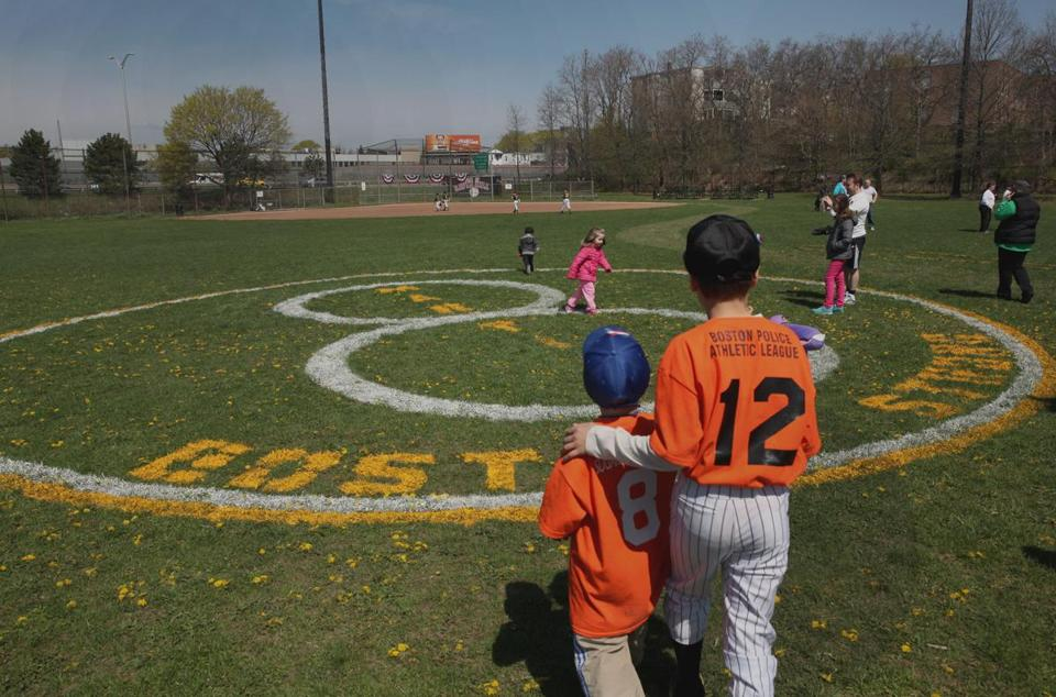 Brothers Andrew and James O'Connell visited the logo honoring Martin Richard, 8, at a Little League field in Savin Hill.