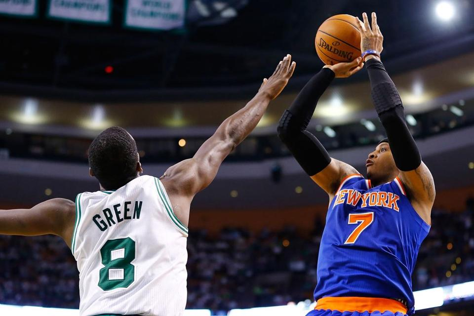 Carmelo Anthony led all scorers, including the Celtics' Jeff Green, with 26 points Friday as the Knicks took a commanding 3-0 series lead in Boston.