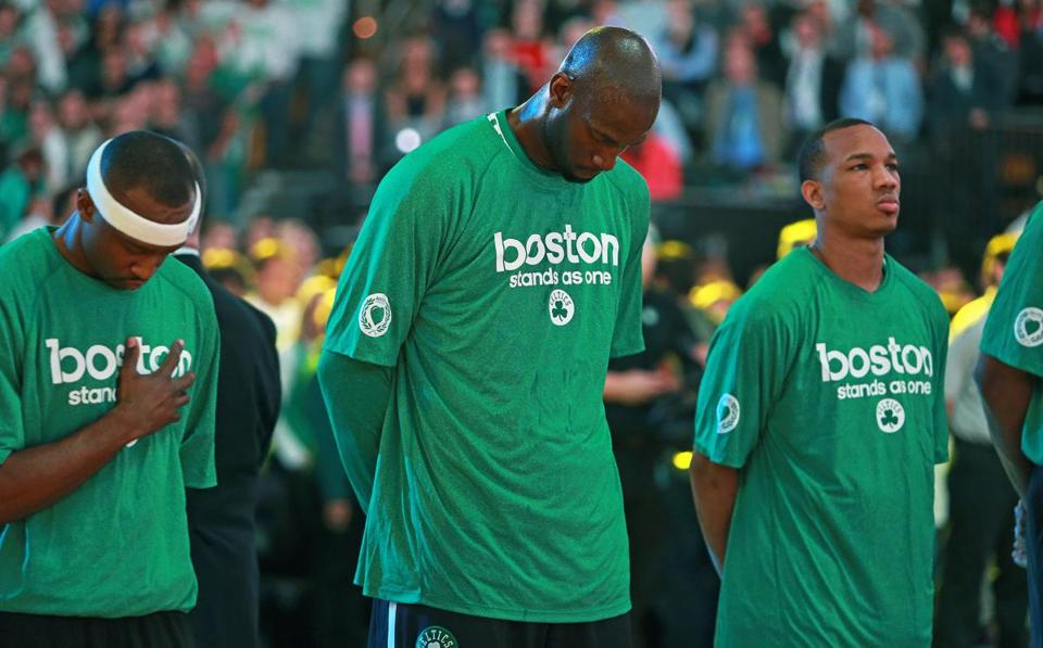 Kevin Garnett (center) and the Celtics paid homage to bombing victims before Game 3.