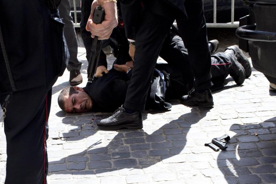 Police officers arrested Luigi Preiti following a shooting outside Palazzo Chigi in Rome.